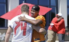 Tampa Bay Buccaneers quarterback Jameis Winston, right foreground, hugs Ali Marpet after working out in an NFL rookie minicamp in Tampa, Fla., Friday, May 8, 2015. (AP Photo/Wilfredo Lee)