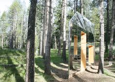 Mirrors clad the walls and rooftops of this woodland installation by architecture studio STMPJ