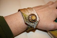 necktie made into a bracelet cuff (using velcro with a decorative button)