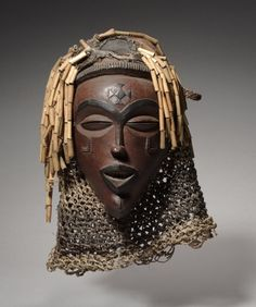 Africa | Female Face Mask. Chokwe peoples, DR Congo or Angola. ca. 1930s.  | Wood,pigment, reeds and fiber.