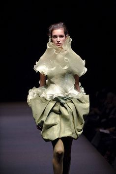 tokyo fashion week <--- yeah nooo. Looks like a butterfly making her way out of a cocoon. Fly away ugly butterfly!