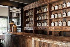 Love these old apothecary desks and shelves. Here well repurposed in a restaurant. La Tortilleria Bodega 8 via www.mr-cup.com