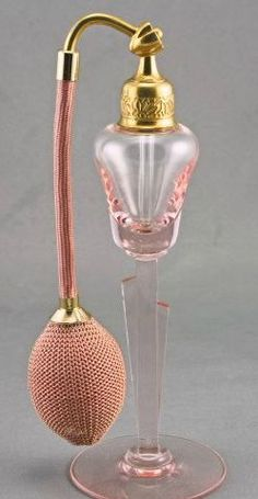 DeVilbiss Art Deco Perfume Atomizer, glowing vibrant pink glass super deco style with geometric stem. Original gleaming brass acorn top hardware is deeply embossed with a deco floral geometric pattern. Pink Perfume, Perfume Atomizer, Antique Perfume Bottles, Vintage Bottles, Parfum Mademoiselle, Beautiful Perfume, Bottle Art, Glamour, Retro