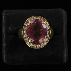 Southern Classic Jewelry - ITALY Period:	CONTEMPORARY Material:	18KT YELLOW GOLD Stones:	8.0 CT PINK TOURMALINE Condition:	A NOTEWORTHY 8.0 CT PINK TOURMALINE IS FEATURED IN THIS LUXURIOUS RING FROM ITALY. THE 18KT YELLOW GOLD MOUNTING IS MAGNIFICENT WITH ITS WIDE GOLD BAND AND THE .50 CT TW OF DIAMONDS ENHANCING THE COLORFUL TOURMALINE. ANOTHER FABULOUS ITALIAN CREATION!  	$2,295.00
