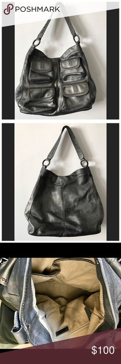 Banana Republic Goa 4 Pocket Hobo Bag $268 Excellent condition Banana Republic Goa 4 Pocket Hobo Bag $268 Rare color: Gunmetal. No rips or stains inside or out. Leather in great condition-interior is clean. Very hard to find!  4-pocket hobo has multiple compartments for ultimate organization. buttery leather in an antique gunmetal grey that has variations in color & is purposely distressed. magnetic closure. Polished iron stud hardware. 4 outer pockets. Solid cotton lining, inner zip pocket…