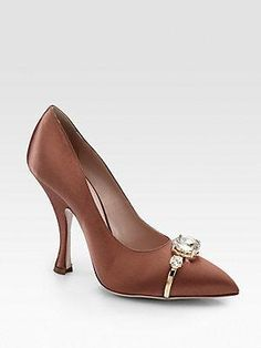 """A sculpted heel lifts this elegant point-toe pump, shimmer-kissed with elaborate crystals. Self-covered heel, 4 """" (110mm) Crystal-encrusted satin upper Point toe Leather lining and sole... More Details"""