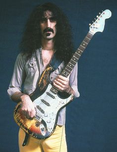 Frank Zappa with the Strat Jimi Hendrix burned onstage at the 1968 Miami Pop Festival.  More info: http://www.fender.com/news/dweezil-zappa-displays-relic-guitar-in-guitar-world-magazine/