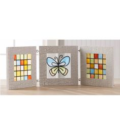 Love this tri-fold butterfly glass frame created using @Alissa Huybers Crafts Gallery Glass Window Color paint!