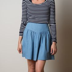 Buy a skirt pattern for a gathered skirt with pockets, either knee length skirt or short gathered skirt, yoke detail and back zipper.