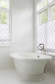 Ethereal Bathroom Boasts A Roll Top Tub Paired With A Floor Mount Vintage  Style Tub Filler Placed Between Windows Dressed In White And Gray Arabesque  Roller ...