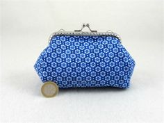 Handmade cotton coin purse in pretty blue tones cotton.   This purse is lined in cotton and interfaced between the two fabrics for structure and durability.   This kiss lock purse can be used for change and credit cards, make up or for small objects and will slip easily into your bag.   Made in France.   One of a kind.   Dimension,  Frame 10 cm / 3.9   Largest part of purse 12 cm / 4.7   Height 8 cm / 3    Please note, the colours may change from monitor to monitor.