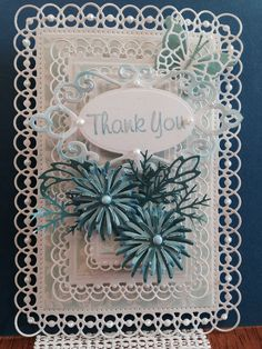 Spellbinders Detailed Scallops dies, Spellbinders Blooms Two dies for flower, Spellbinders Fancy Tags Two, Memory Box Leaves dies, Fiskars punch for twigs, Liquid Pearls, The Paper Studio Pearlized card stock, DCWV Bright Metallics card stock