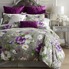 A bevy of violet and white blossoms dance on a neutral gray background with feminine grace and sweet sophistication. Our smooth percale Misted Blooms cotton duvet cover and shams set a lovely background for the decorative pillows finished with textured embroidery. What a lovely way to end your day—snuggled into bouquets of dainty flowers.