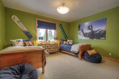 Great kids bedroom that has lots of vibrant color and inspires kids to get up and get on the mountain! Take a look at some of our other projects at www.tatomdesign.com