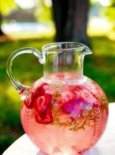 Dehydrated,Frozen strawberries,And slices of rhubarb,A sprig of rosemary,And lashings of soda water.A refreshing summer drink.© Caro Ness 2015