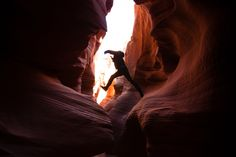 Van Duzer wanders through the tight walls of Secret Canyon, a network of slot canyons on a Navajo reservation near Page, Utah. Photograph by Robert Wright
