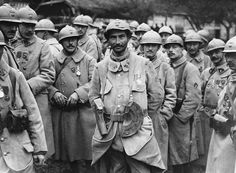 French soldiers pose with the medals they were awarded at the Battle of the Somme in 1916