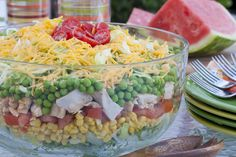 Rainbow Stacked Salad - If you put the dressing on top of the vegetables and chill overnight, then toss just before serving, the salad can be made the day before and all veggies still crisp. Chopped raw carrots would be a nice addition,