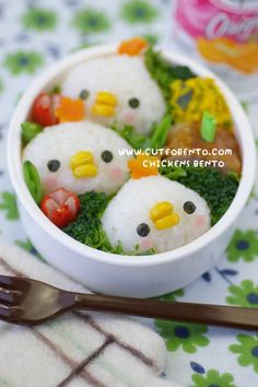 Cute Chicken rice balls.  Their beaks are pieces of corn!