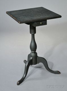 18th c. Queen Anne candle stand with under hanging drawer in black paint.  skinnerinc.com