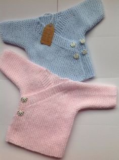 Hand knitted baby wrap cardiga