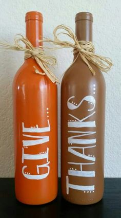 Easy and cute Thanksgiving decoration. Made with two wine bottles, brown, orange and white paint, and some twine.