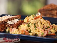 Get Smoked Salmon and Scallion Scramble with Whole Grain Toast with Goat Cheese Butter Recipe from Food Network