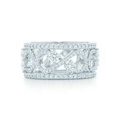 Tiffany Enchant Scroll Band Ring in platinum with diamonds, 9 mm wide.