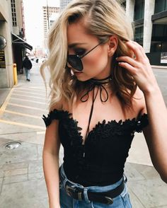 Street style fashion blogger pairs black sheer maxi dress from boohoo with frayed denim jeans and black strappy heels. Click here to see more of this look.