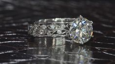 To see this at a store near you: https://www.bezambar.com/bez-ambar-store-locator/  A vintage style engagement ring with an engraved, decorative shank and a round brilliant cut diamond center. #Club_Glamour #Fashion #Trends #Jewelry #Rings #necklaces #pendants  #jewelry #handmadejewelry #instajewelry #jewelrygram #fashionjewelry #jewelrydesign #jewelrydesigner #FineJewelry #jewelryaddict #bohojewelry #etsyjewelry #vintagejewelry #customjewelry #statementjewelry #jewelrylover #silverjewelry…