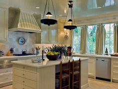 Kitchen Island with Chandeliers - 99 Beautiful Kitchen Island Design Ideas on HGTV Love the idea of the drawers on the end of the island!