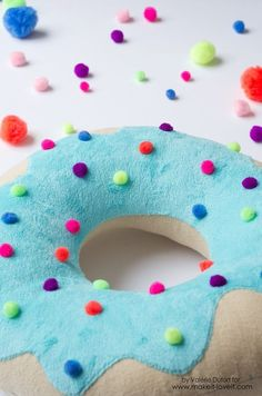 Sew a fun pillow with your kids using this Delicious Donut Pillow Tutorial. With this easy step-by-step photo tutorial, create colorfull home decor or toys!