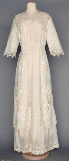 """White Lace Tea Gown, C. 1910, Augusta Auctions, April 9, 2014 - NYC, Lot 179 1-piece cotton lawn w/ embroidery, filet lace, Val lace & Irish crochet, B 36"""", W 29"""", L 57"""", (few tiny pin holes in lawn, several holes in lace) very good."""