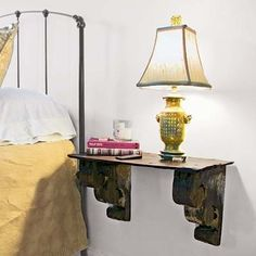 Handsome--and affordable--bedside table made of wood corbels topped by a slate roof shingle. | Photo: Cressida Payavis | thisoldhouse.com by robyn