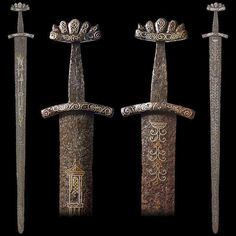 Viking sword, the hilt of Petersen type o, cross-guard with decorative devices reminiscent of those on one of the three swords from the 10th c burial ship at Hedeby in Denmark, excavated in the 1950s. More of these 'rabbit ear' or 'knotted rope' characters may be found on three of the 'Hiltipreht' group of swords, the Wallace Collection (Inv. No. A456), the Ballinderry sword, National Museum of Ireland, (Inv. No.1928.382), from the Malhus, Trondheim Museum, (Petersen, Abb.89).