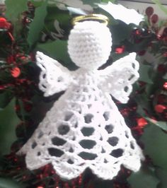 Ravelry: Table Angel pattern by Eric ElsonA 3 high, delicate lace cotton angel, worked with chain, double crochet and treble stitches. Crochet Christmas Decorations, Crochet Ornaments, Christmas Crochet Patterns, Crochet Snowflakes, Christmas Crafts For Gifts, Ornament Crafts, Angel Ornaments, Christmas Angels, Christmas Christmas