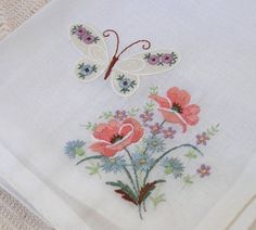 A sweet Swiss cotton hanky. A pretty butterfly flutters above some pretty flowers. sticker: Swiss Made, The hanky measures x It is in nice vintage condition. Vintage Butterfly, Butterfly Flowers, Crewel Embroidery, Embroidery Patterns, Handkerchief Crafts, Hand Work Design, Embroidered Towels, Crochet Tablecloth, Sewing Box