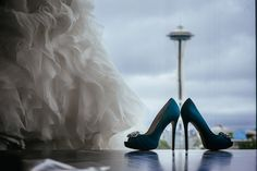Matt Shumate Photography at the Pan Pacific Hotel in Seattle, WA really cool picture of the brides teal wedding shoes and dress hanging in hotel room window with view of the Space Needle Teal Wedding Shoes, Seattle Hotels, Seattle Wedding, Wedding Portraits, Wedding Pictures, Portrait Photographers, Getting Married, Cool Pictures, Our Wedding