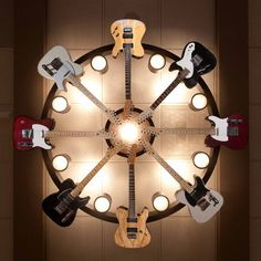 6 Fender guitar chandelier. #music #interiors #lighting #fender #guitars  #musicinteriors #guitar http://www.pinterest.com/TheHitman14/music-interiordecor-%2B/