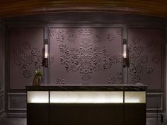 ***LOVE THIS FOR LIVING ROOM!***A delicately cut and sculpted purple leather wall by London based artist Helen Murray sets off the reception desk at the St. Regis Hotel in Aspen. Interior design by Rottet Studio. Photo by Eric Laignel Hotel Reception Desk, Lobby Reception, Reception Areas, Lobby Interior, Interior Exterior, Interior Design, Stylish Interior, Interior Walls, Design Hotel