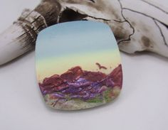 Handmade Polymer Clay 36mm Focal-Southwestern Themed-Catalina Mountains Tucson AZ-Desert View-PA 9474 Collection: Escape........................... Series: Catalina Mountains Tucson AZ  Each panorama is created by a special method of layering, blending and sculpting multiple polymer clay colors. This technique results in a beautiful abstract composition of mountain, sky and landscapes. Specifications: Listing is for one bead. Approximately 36mm. This bead has been sanded and has a matte…