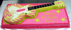 Pink and green animal print guitar cake