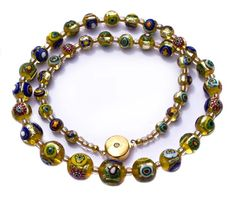 Exquisite antique Venetian millefiori foil bead necklace. The graduated foil beads are in excellent condition. The necklace has been restrung using a beautiful gold tone clasp with a Swarovski crystal chip in the center on both sides. The necklace measures approx. 18 inches in length.SOLD