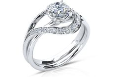 Pave set Diamond Ring-Like lovers hearts are inextricably entwined this wedding ring fits together flawlessly with the matching engagement ring like two pieces of a puzzle.