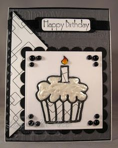 "White Opal Liquid Pearls ""frosting"" makes this cupcake look good enough to eat!  The black and white colors make this handmade birthday card very classy."