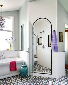 """Cement tiles are great for a bathroom floor because their textured surface has a grip to it. """"It's not slippery,"""" says Vidal. """"And it's super durable and easy to maintain. If you somehow manage to stain it, you can always sand it down — because the color is integral to the tile — and reseal it."""""""