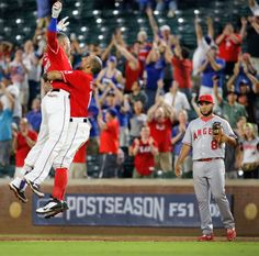 Ian Desmond gets a leaping hug from Rougned Odor  after Desmond's ninth-inning…