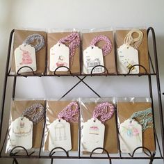 Good idea - putting cardboard behind the tags to make them stand out in the cellaphane bag