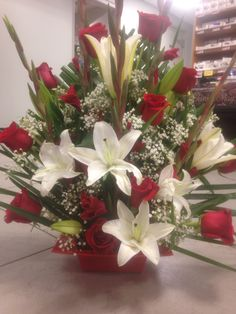 Braided palm in the back , gladiolus lilys roses & gyp