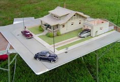 Cool old Studebaker in front of a bungalow. Nope, this is a scale model (diorama). pic 3 of 3 Revell Model Cars, Miniature Cars, Miniature Houses, Craftsman Bungalows, Train Layouts, Small World, Paul Smith, Dollhouse Miniatures, Dollhouse Ideas
